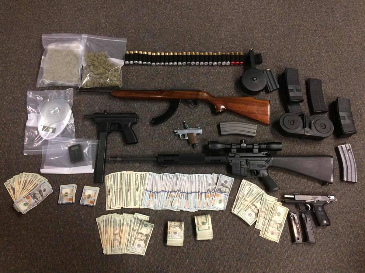 Cops seize guns, cash, drugs