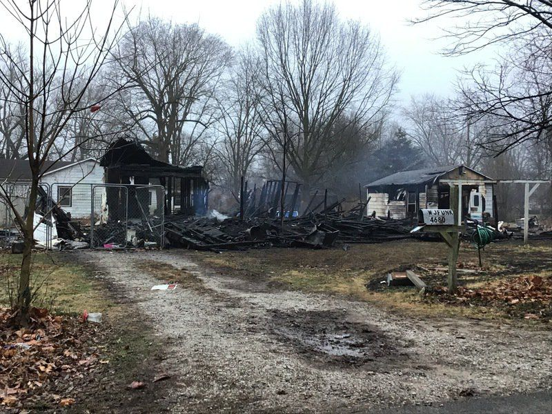 Fire destroys house on Hall Avenue; occupant arrested