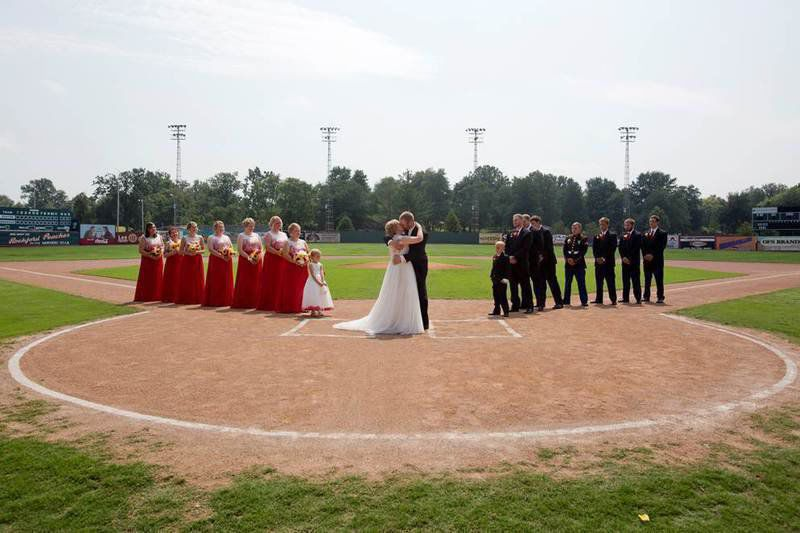 indiana couple weds at a league of their own stadium features