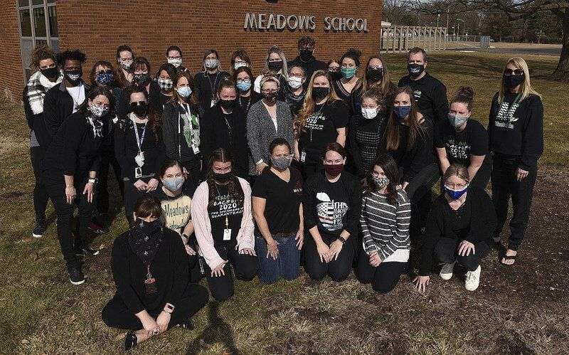 Teachers protest by wearing black