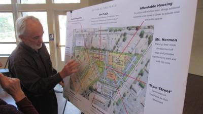Jon Worden shows the plans for the Town Center