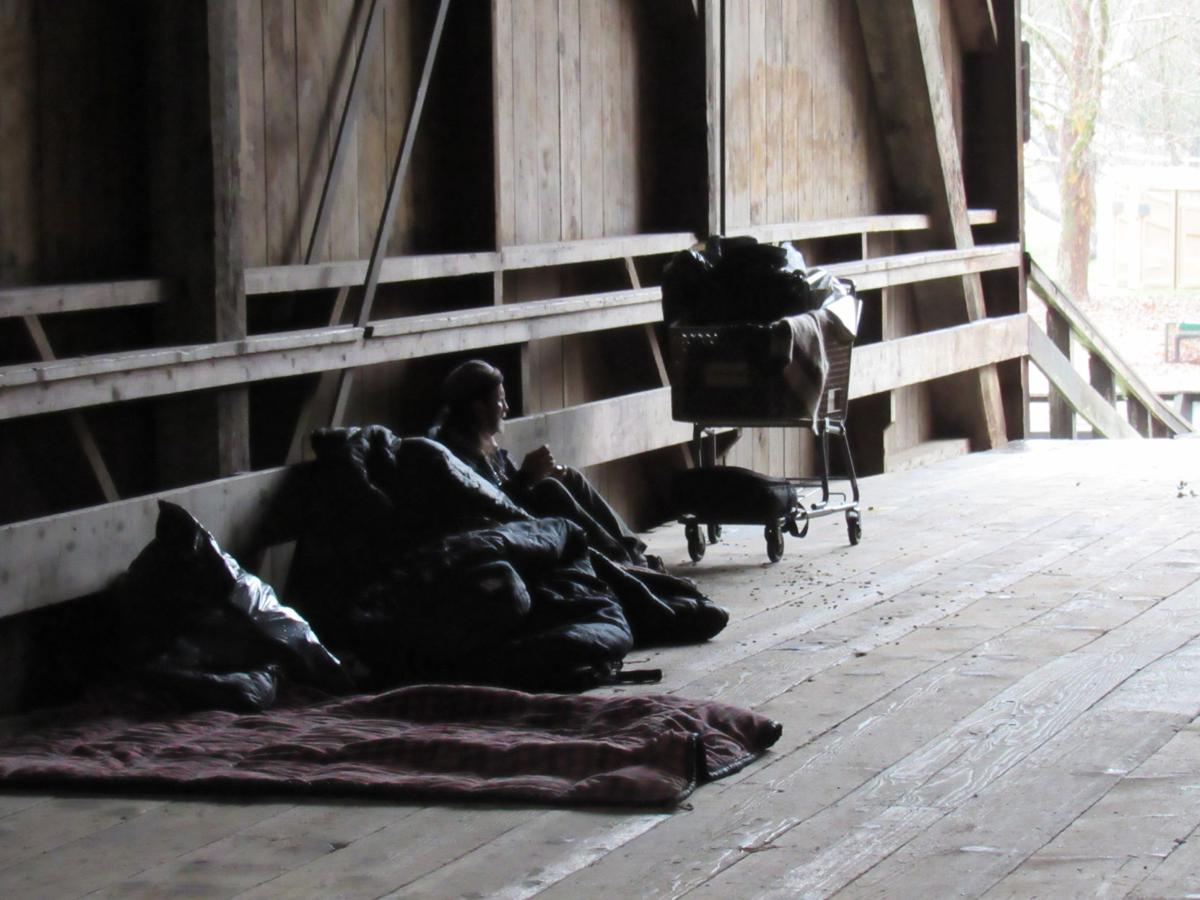 A homeless person in the Felton Covered Bridge.