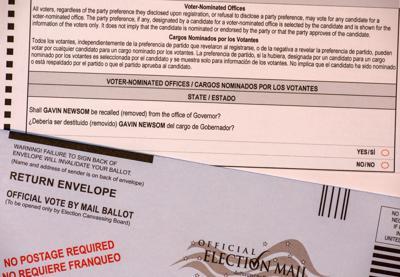 Official ballot to recall California Governor Gavin Newsom during California Gubernatorial Recall Election. Postage paid return envelope - San Jose, California, USA - August 18, 2021