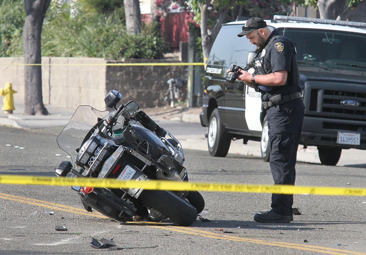 Motorcycle officer injured in crash