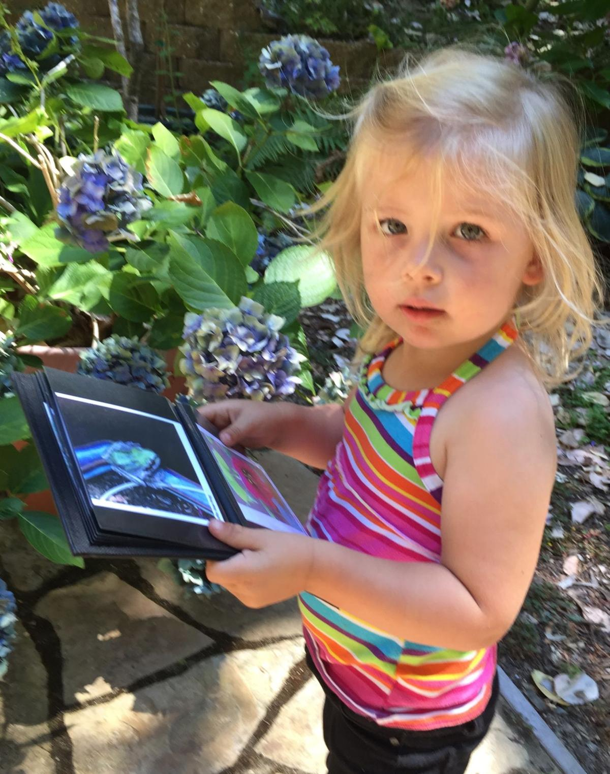 Adelyn Biles in my garden several years ago looking for flowers, frogs and insects featured in her nature book.