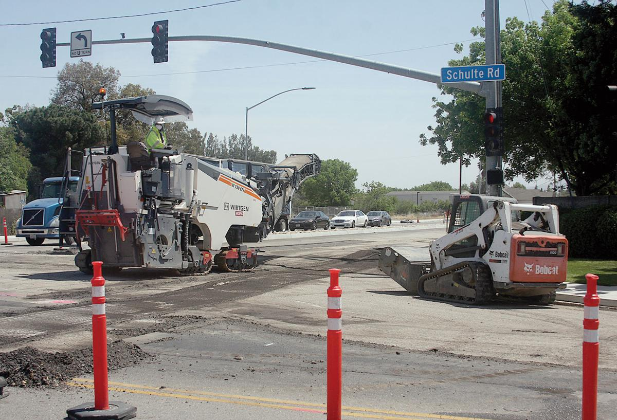 Council OKs additional costs for street widening