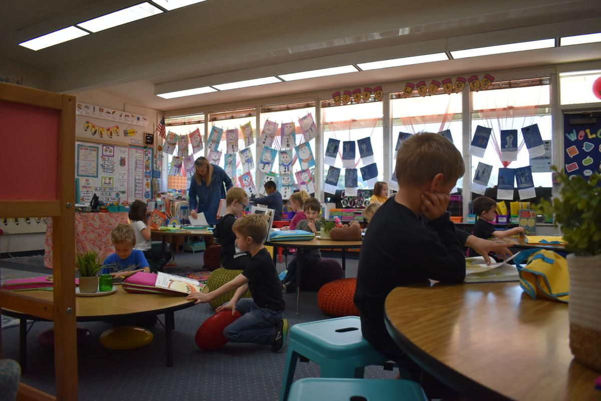 First graders at Vine Hill Elementary read in their best spot.
