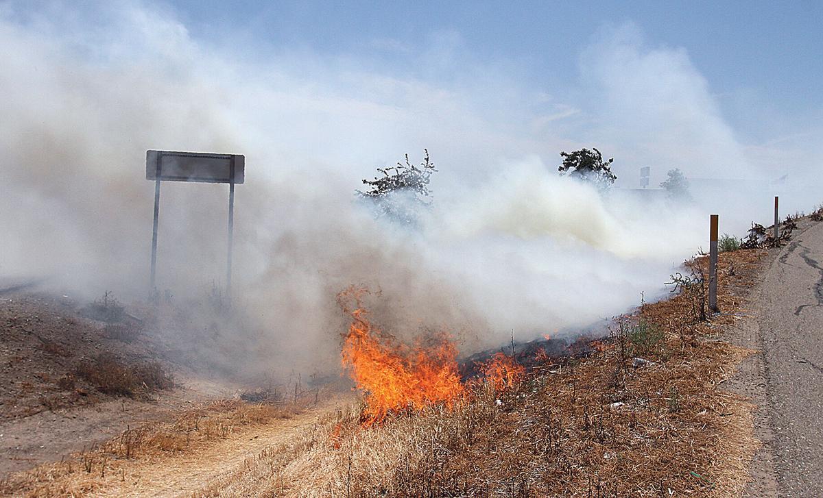 Grass fire on I-205