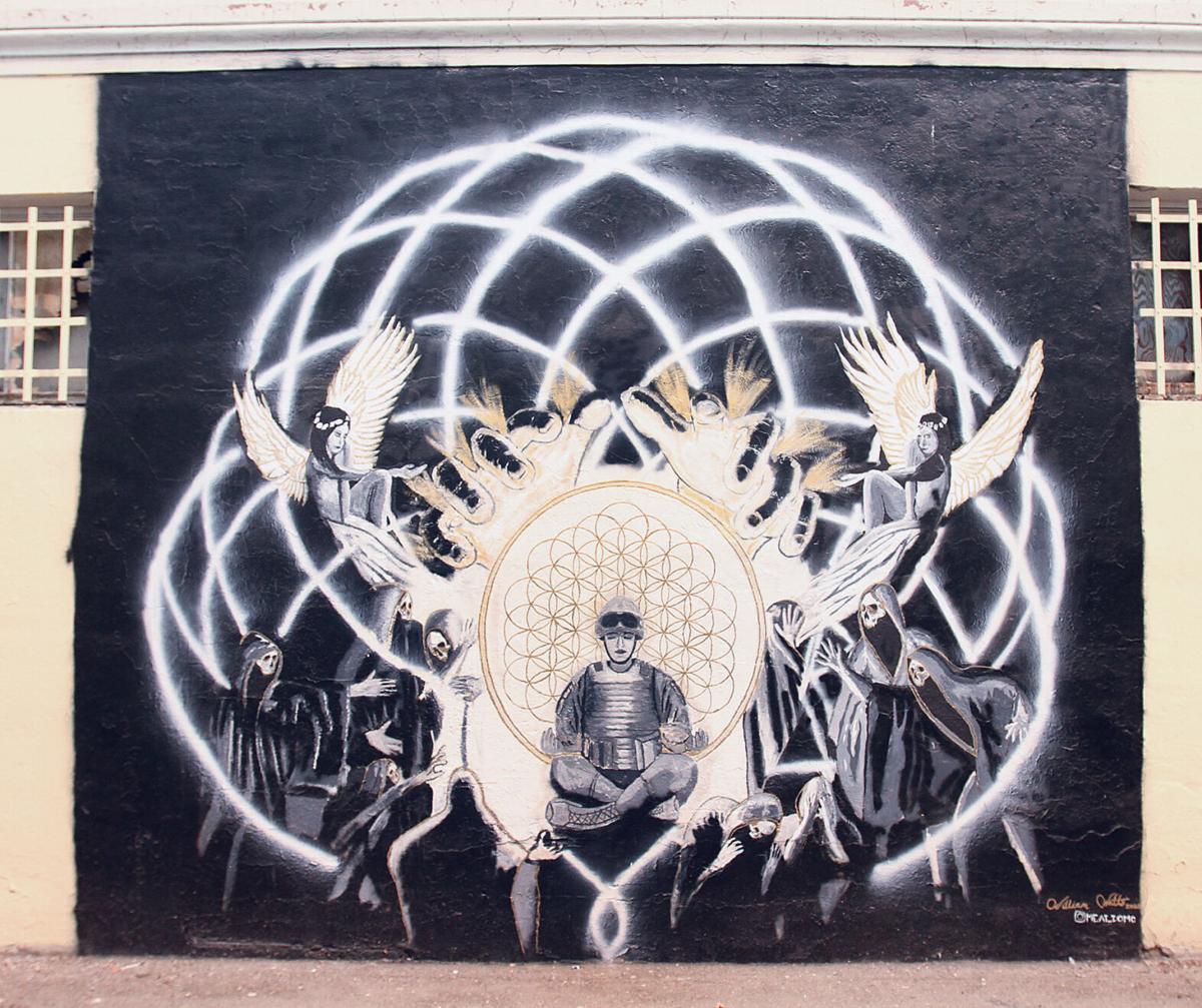 Veteran paints downtown mural