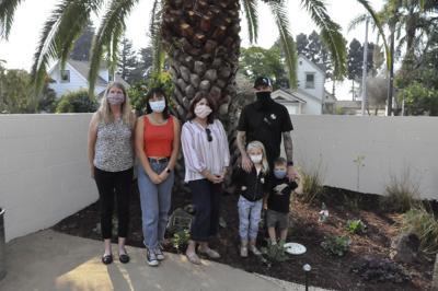 (Left to Right):Peggy Kier, Seri Thompson, Siena House BOD Pres. Donna Miller, Jeremy Ross, Cora &Wyatt