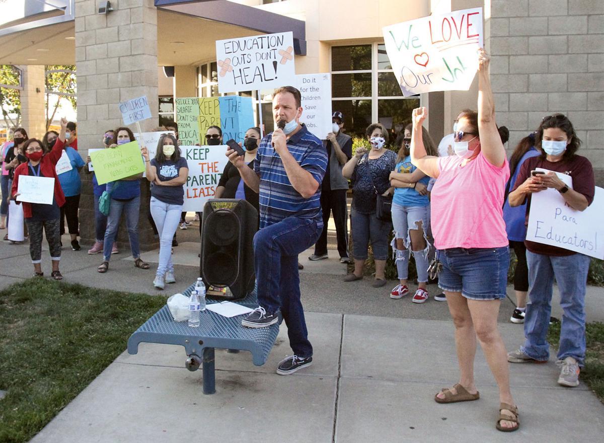 Staff protests layoffs