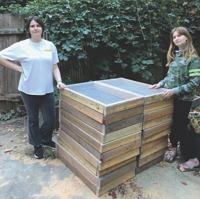 Mikayla, left, and Cheyenne Casey with a stack of their sifter boxes. — Judi Casey