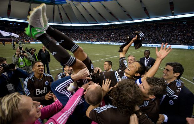 Vancouver players throw teammate Lee Young Pyo into air