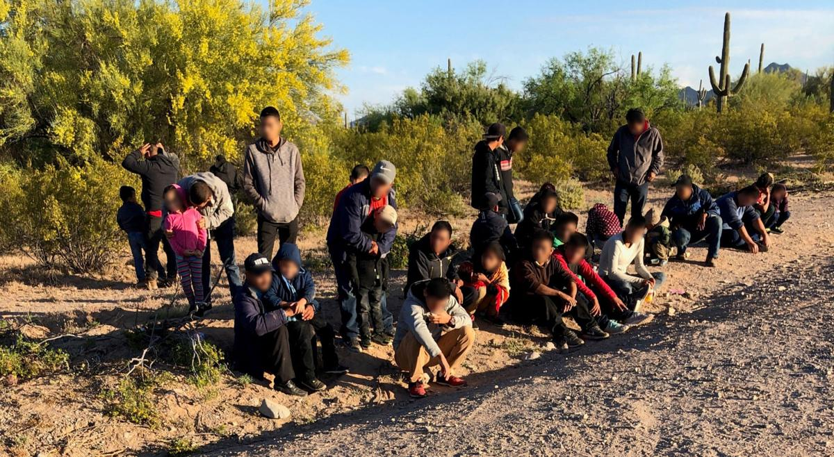Migrants surrender to Border Patrol agents near Lukeville on April 16
