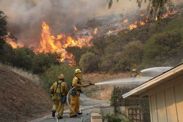 S. Calif. fire spreads; up to 15 homes damaged