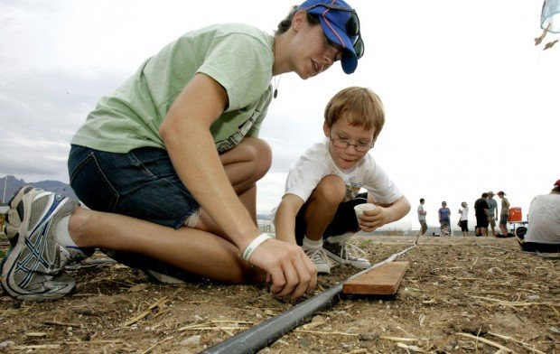 Finding where food comes from: Kids, parents plant, harvest with Big Green Bus, UA farm