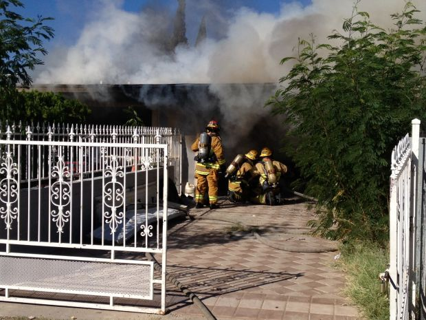 Man found in burning north Tucson home hospitalized