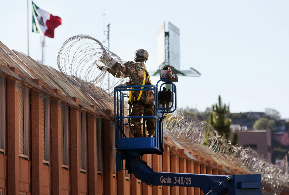 Troops install concertina wire at border fence