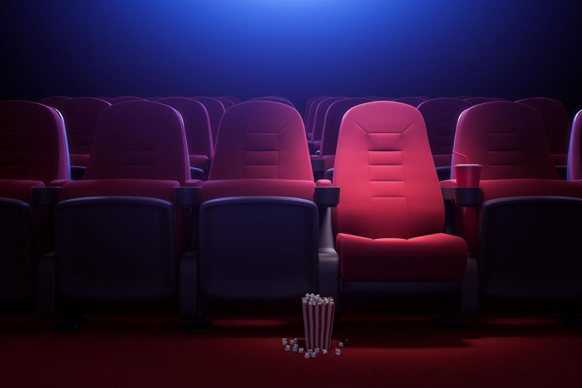 Row of empty red cinema seats