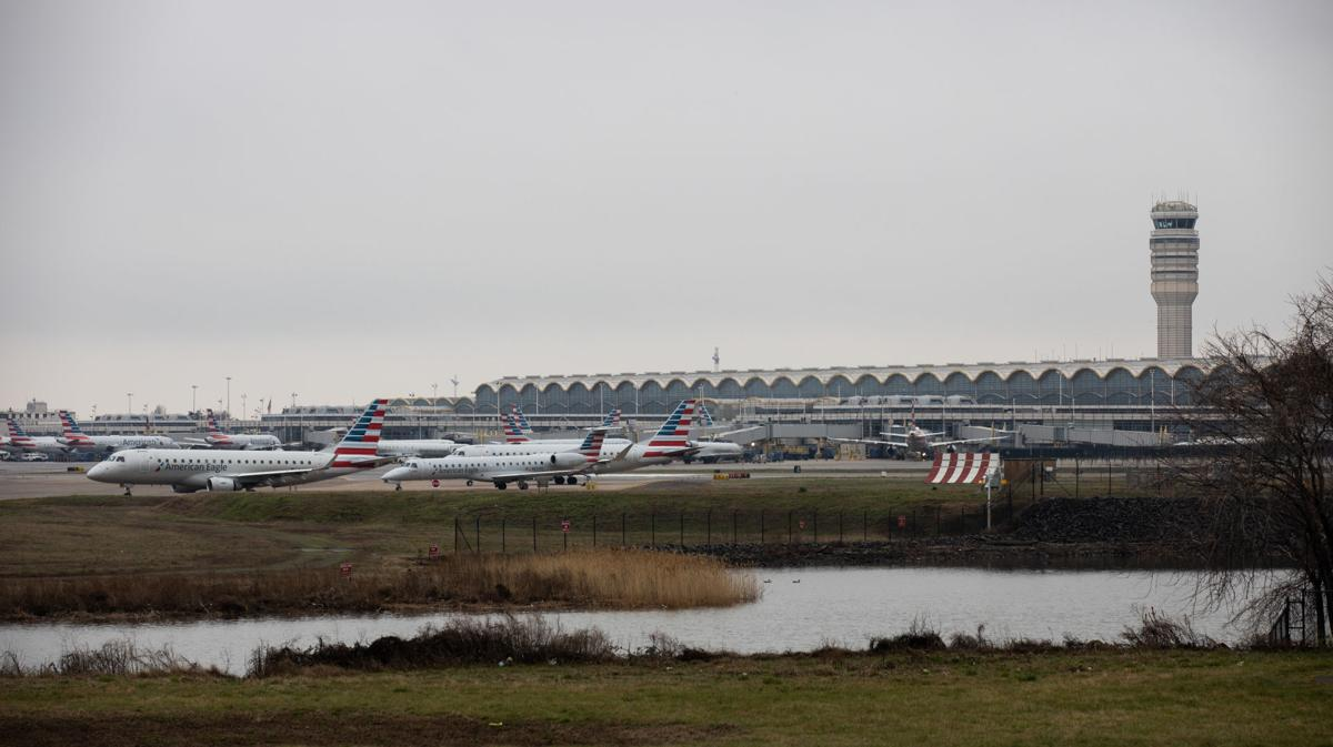 An American Airlines planes are seen at Ronald Regan National Airport in Washington, D.C. on Friday March 13, 2020. President Donald Trump has imposed a travel ban on 26 European countries after the World Health Organization named the coronavirus a global pandemic. The decision has major consequences for the world of travel and travelers.
