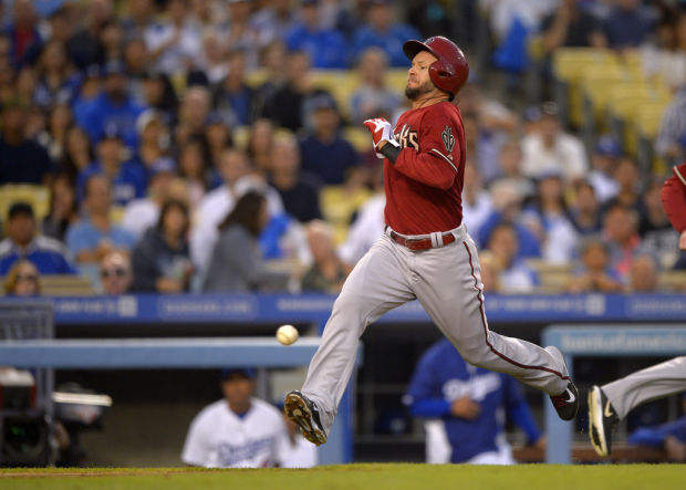 D-backs 8, Dodgers 6: D-backs win in 12th, will open '14 in Australia