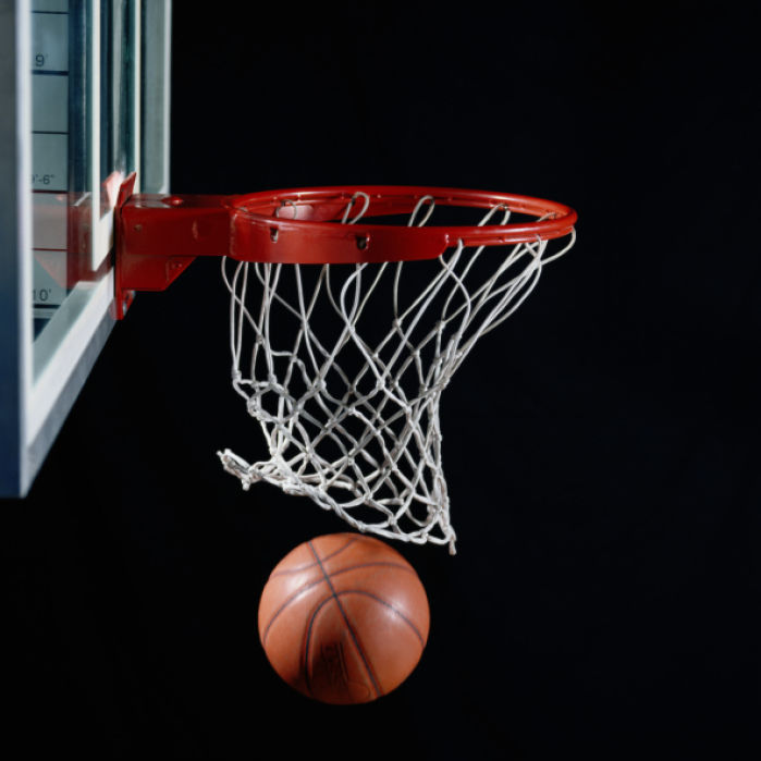 Basketball in hoop stock image