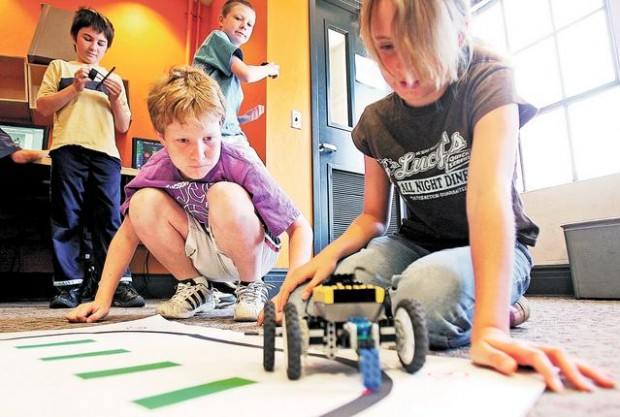 Kids learn science, math with Robots