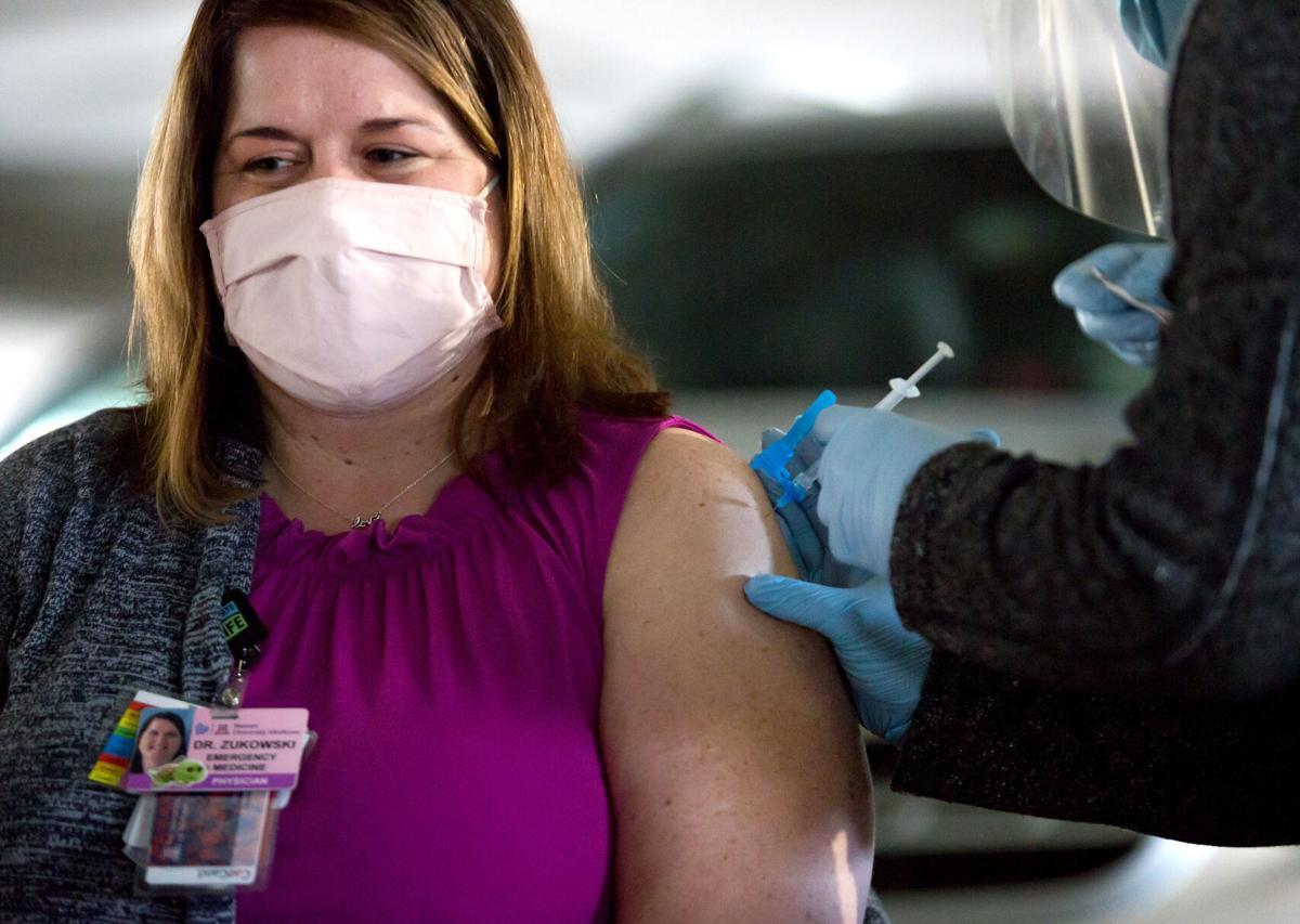 UMC workers get COVID-19 vaccine