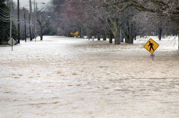 Floodwaters rising after heartland rains, and other national news
