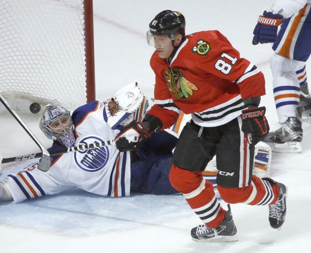 NHL: Blackhawks stay unbeaten with Hossa's overtime goal
