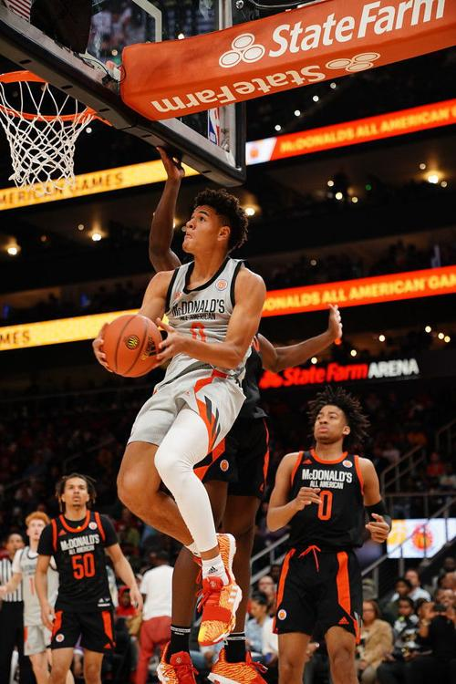 1b2ce986f524 Josh Green reverses under the basket for two points on an assist by Nico  Mannion during the McDonald s All-American Game. Both future Wildcats  finished with ...