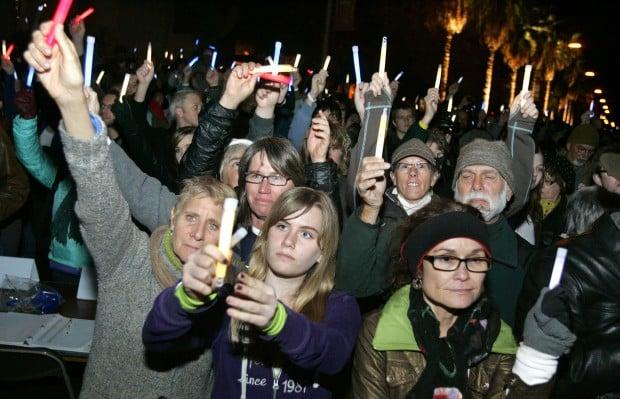 Thousands give Giffords a warm welcome at vigil Across city, memorials, a vigil bring a sense of togetherness