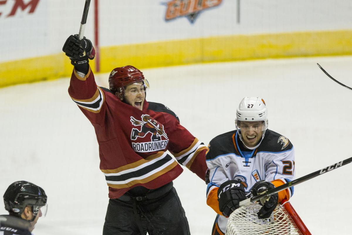 Tucson Roadrunners left wing Brendan Perlini cheers after assisting in a goal.