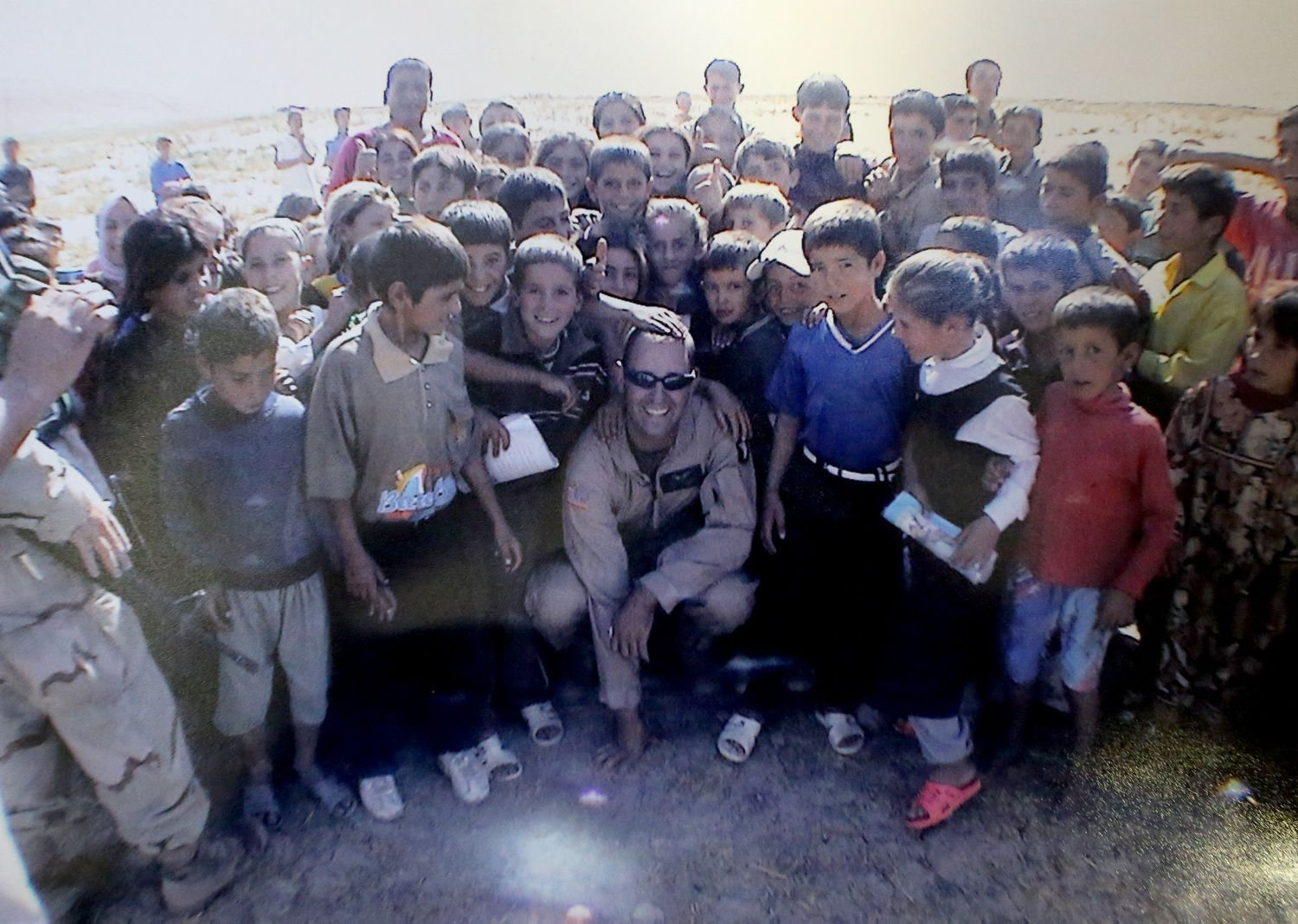 315a897f026 This is a Fall 2003 photograph of former Black Hawk helicopter pilot Brett  Rustand with children while he was in Northern Iraq.