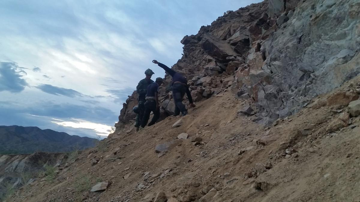 Illegal immigrants rescued from open-pit mine