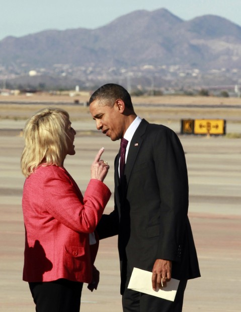 Obama steps off his jet into a clash with Brewer