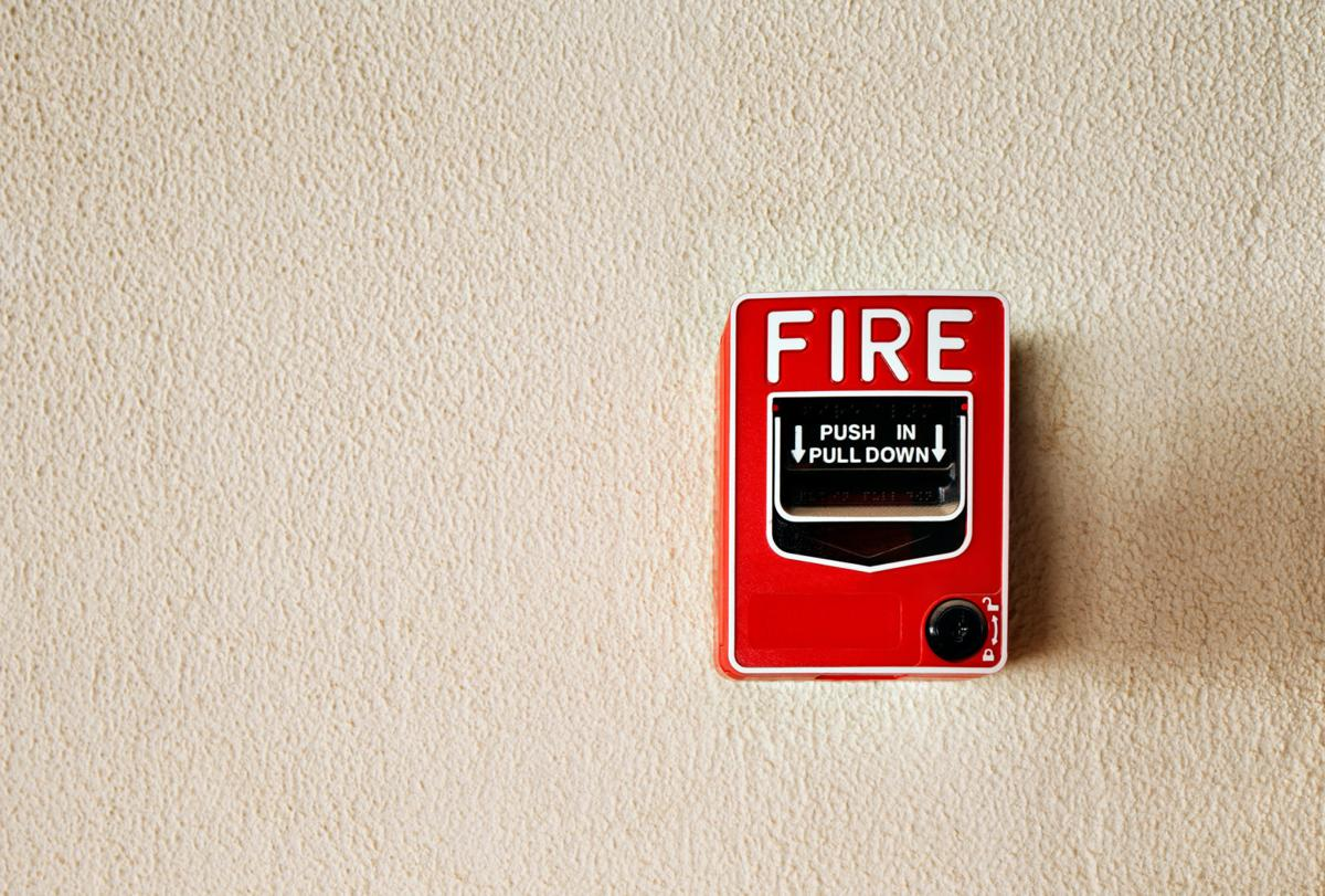 Fire alarm button on a wall