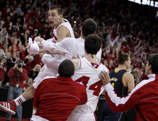 College Basketball: Brust buckets drive Badgers past Mich.