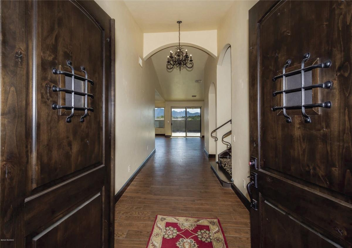 9-ft-custom-doors-with-speakeasy-windows-open-to-the-home-s-Great-Hall-and-view-of-the-Catalina-Mountains.jpg