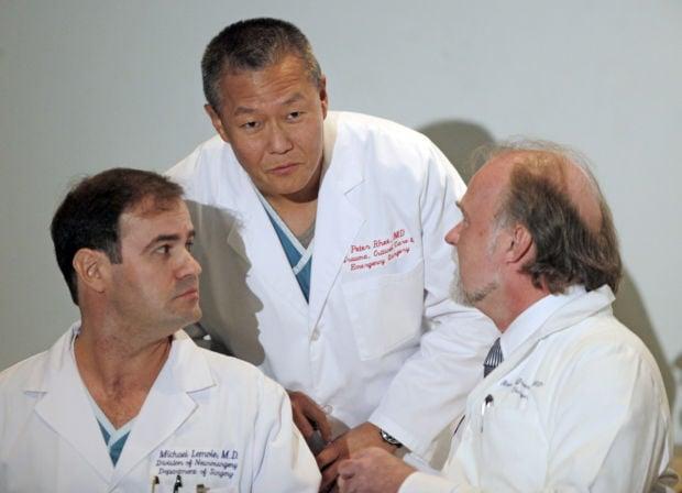 Dr. Peter Rhee, Dr. Michael Lemole, Dr. Rainer Gruessner