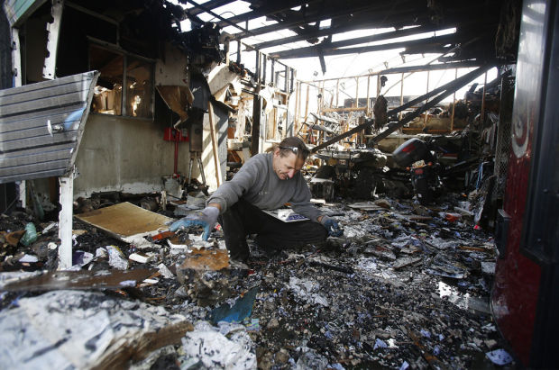Fire rips midtown auto shop