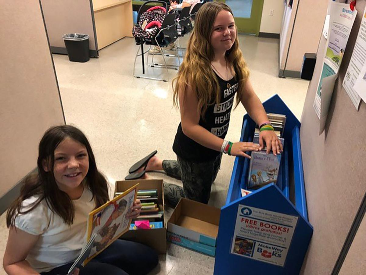 Blue Book House Project promotes reading by children