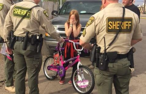 Sheriff's deputies buy girl a new bike after she loses hers in a fire