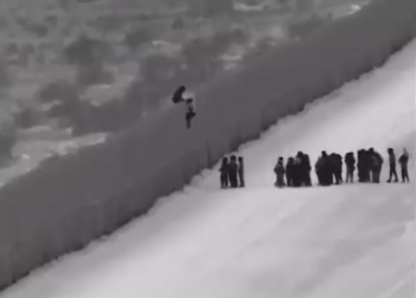 Central American asylum seekers scaling border wall