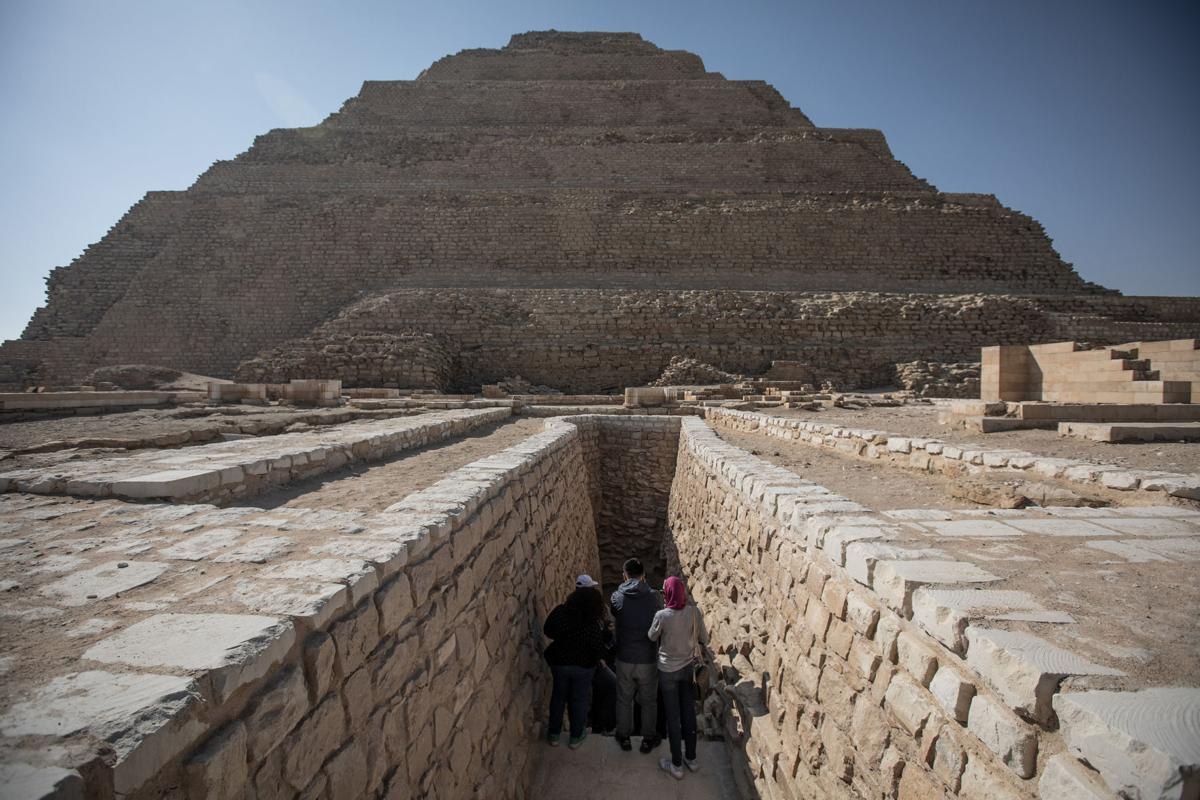 People enter the Pyramid of Djoser in Saqqara outside Cairo on March 5, 2020. Also know as the Step Pyramid, the believed world's earliest stone structure reopened again for tourists after almost 20 years of renovations. The Pyramid of Djoser was built during the Third Dynasty in 27th century BC for the burial of Pharaoh Djoser.