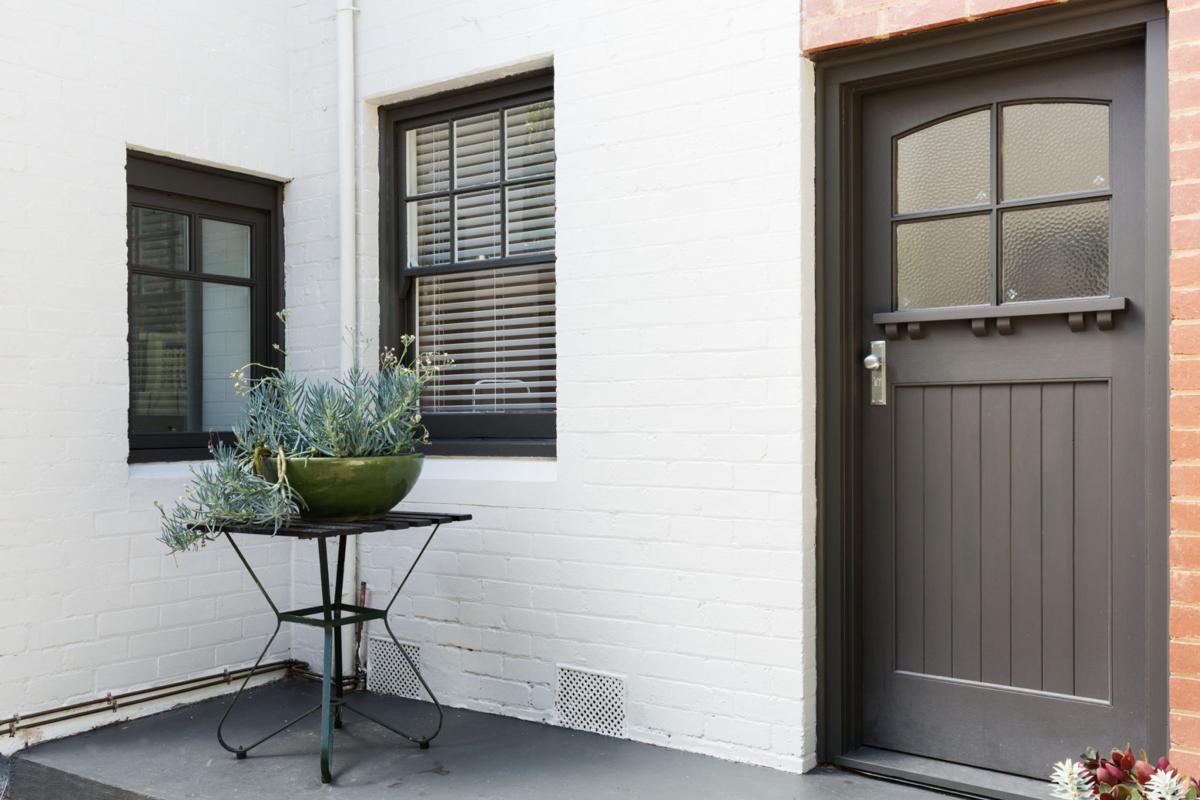 Entry porch and front door of an art deco style apartment