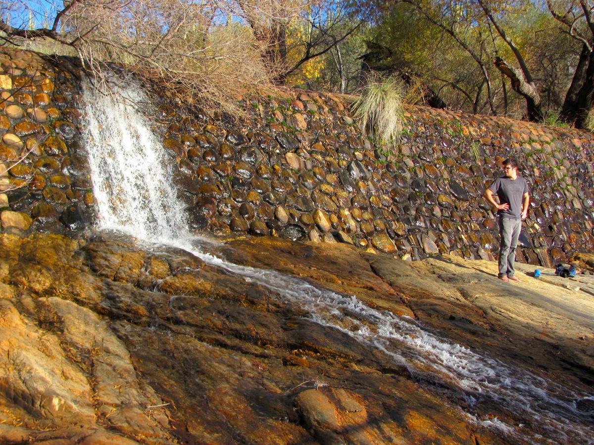 Hiker and Sabino Dam