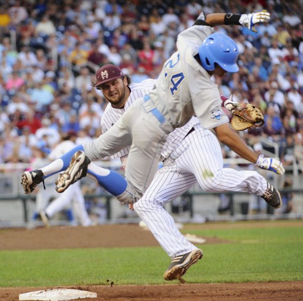 College World Series: Bruins survive, take series lead