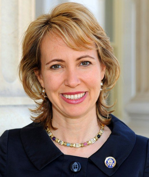 Giffords can squeeze hand, hold up fingers
