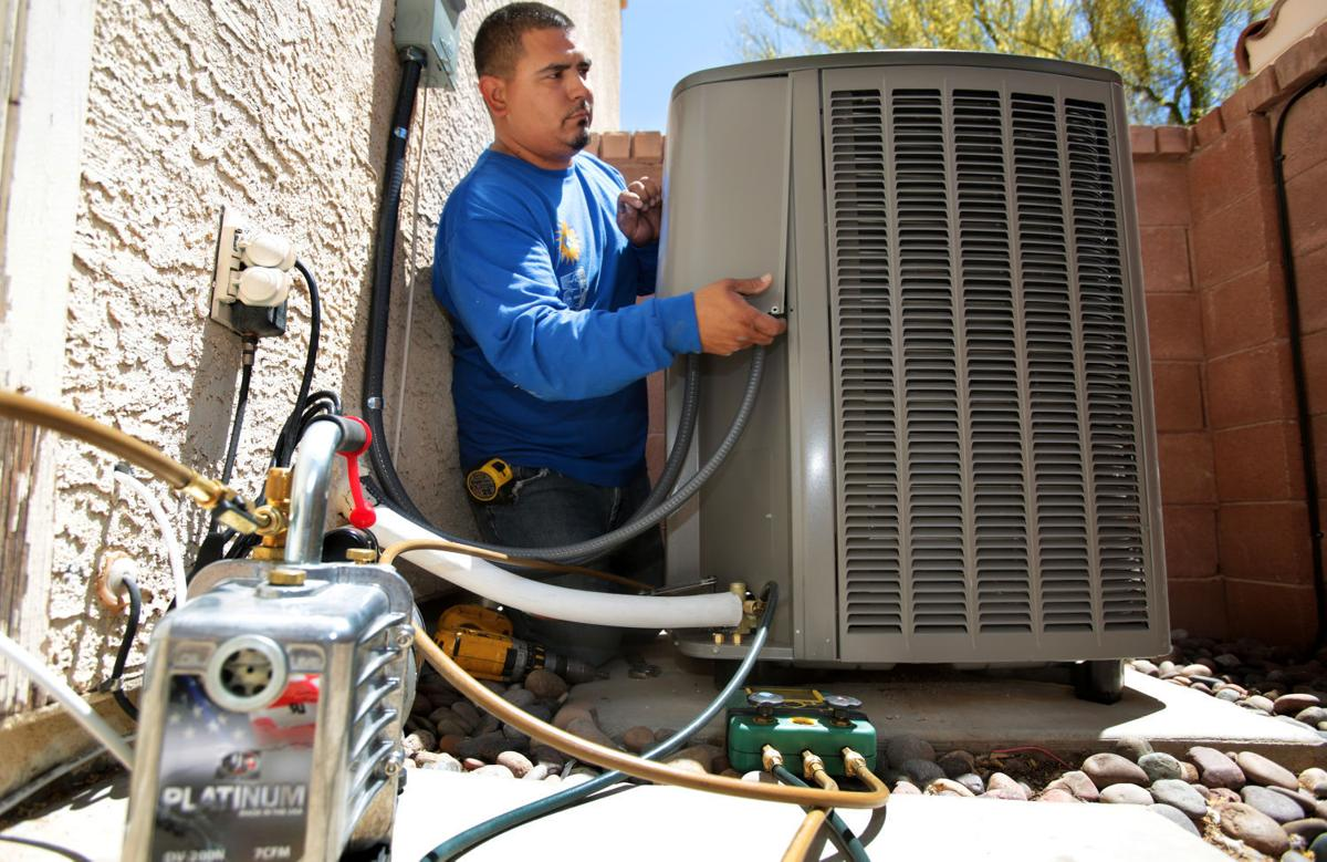 Inc Employee Ray Chavez Installs A New Lennox Air Conditioning Unit On Residential Home At 10 297 N Hardage Lane In Oro Valley Az